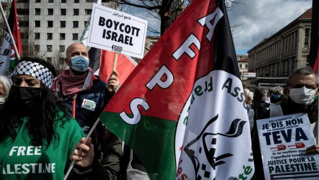 A pro-Palestinian demonstration in Lyon, France, before the trial of political activist Olivia Zemor for her call to boycott the Israeli pharmaceutical company Teva, March 16, 2021. (Photo/JTA-Jeff Pachoud-AFP via Getty Images)