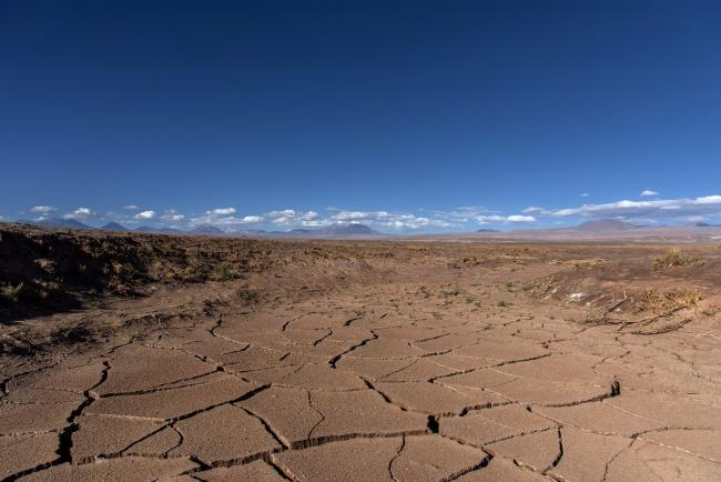 Dry and cracked ground marks an area where water is being pumped by mining companies in the southern tip of the Atacama salt flat.  Photographer: Cristobal Olivares/Bloomberg