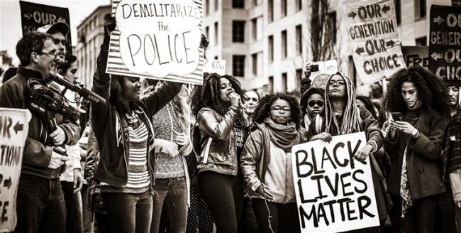 A Black Lives Matter protest (November 2015). Photo by Johnny Silvercloud via Wikimedia Commons.