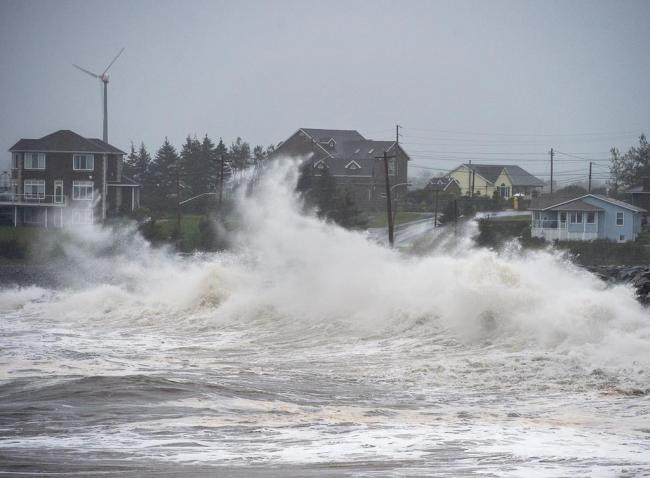Waves caused by Hurricane Teddy batter the shore in Cow Bay, N.S., on Wednesday, Sept. 23, 2020. THE CANADIAN PRESS/Andrew Vaughan