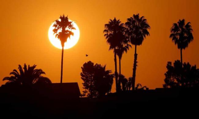 The sun rises over a neighborhood in Encinitas, California, amid a heatwave last year. Photograph: Mike Blake/Reuters