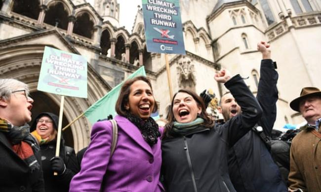 Munira Wilson and Sarah Olney, the MPs for Twickenham and Richmond Park, cheer alongisde other campaigners outside the Royal Courts of Justice in London after the ruling. Photograph: Stefan Rousseau/PA