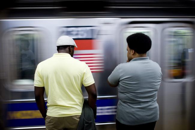Passengers wait to board a New York City subway train. Fabrizio Lonzini / Flickr