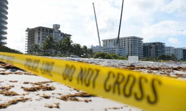 The disaster has highlighted the precarious situation of building and maintaining high-rise apartments in an area under increasing pressure from sea level rise. Photograph: Larry Marano/Rex/Shutterstock