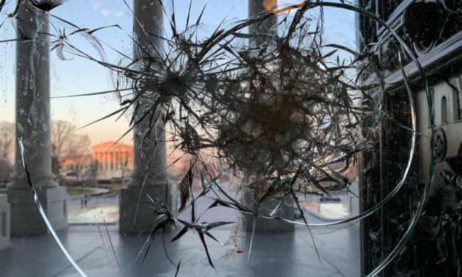A window at the US Capitol building broken by supporters of US President Donald Trump. Photograph: Dmitry Kirsanov/TASS