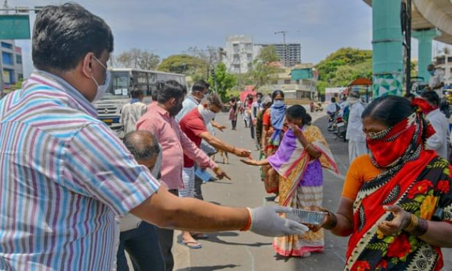 'There is no guarantee that this resurgence of collective action will survive the pandemic. But I think it will.' People distribute free food in Bangalore, India. Photograph: Manjunath Kiran/AFP via Getty Images