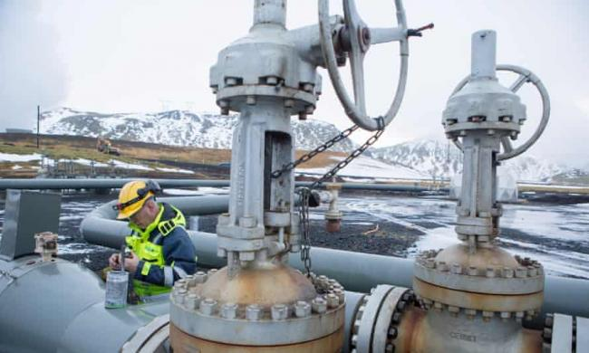 A worker on a Carbfix carbon injection well in Iceland in 2017. The company is involved in the new Orca plant designed to draw carbon dioxide out of the air and store it as rock. Photograph: Christian Science Monitor/Getty Images