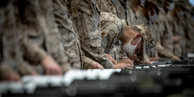 A recruit receives his weapon at the Marine Corps Recruit Depot in San Diego on March 1, 2021. Photo: Lance Cpl. Zachary Beatty/ U.S. Marine Corps
