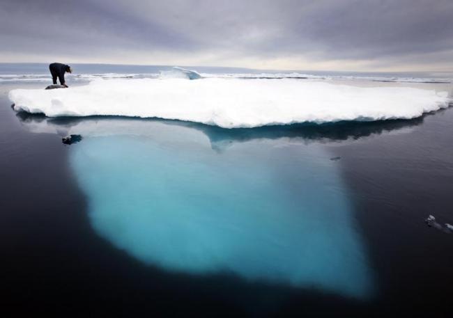 """FILE - In this file photo dated July 2007, an Inuit seal hunter touches a dead seal atop a melting iceberg near Ammassalik Island, Greenland. The left-leaning  government on Greenland which could be sitting on vast amounts of oil, has decided to suspend all oil exploration, Friday July 16, 2021, calling it """"a natural step"""" because the Arctic government """"takes the climate crisis seriously."""" (AP Photo/John McConnico, FILE) AP NEWS Top Stories Video Contact Us Cookie Settings DOWNLOAD AP NEWS Connect with the"""