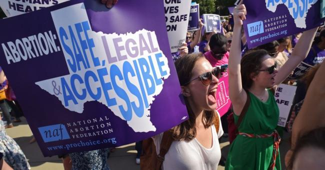 Reproductive rights activists hold placards and chant outside of the U.S. Supreme Court ahead of a ruling on abortion clinic restrictions on June 27, 2016 in Washington, D.C. (Photo: Mandel Ngan/AFP via Getty Images)