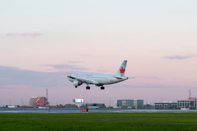 Air Canada plane landing - We're bailing out Air Canada with a near $6-billion package. Will we get our money's worth? Photo via Shutterstock.