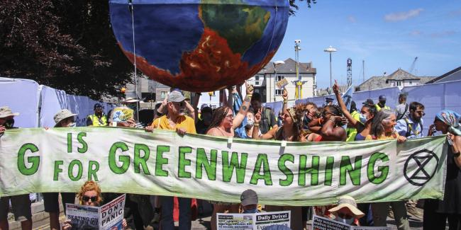 Protesters critical of the Group of Seven countries' climate policy call for strong action on climate change during a rally in Cornwall, England, on June 12, 2021. Photo: Kyodo via AP Images