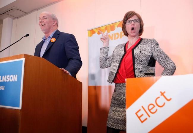 NDP candidate Sheila Malcolmson celebrates with Premier John Horgan after winning the byelection in Nanaimo, B.C., on Wednesday, January 30, 2019. Photo by The Canadian Press/Chad Hipolito