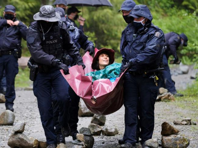 RCMP officers carry a woman they arrested at the Waterfall camp blockade against old growth timber logging in the Fairy Creek area of Vancouver Island last May. While law enforcement usually prevails in instances of environmental protests, this week other values triumphed in a B.C. Supreme Court ruling. PHOTO BY JENNIFER OSBORNE /REUTERS file