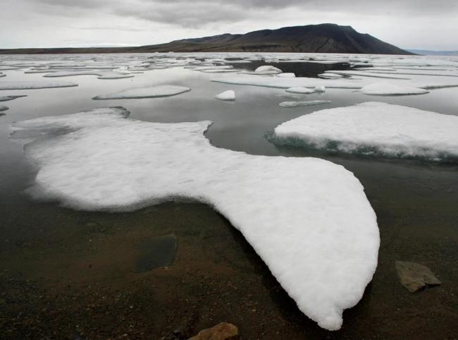 Ice floats in Slidre Fjord outside the Eureka Weather Station, on Ellesmere Island, Nunavut, on Monday, July 24, 2006. File photo by The Canadian Press/Jeff McIntosh