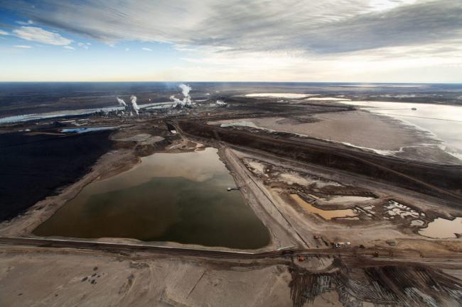 A new report confirms what communities close to the Alberta oilsands have long suspected: tailings ponds are leaking and toxic fluids are making their way into groundwater and tributaries of the Athabasca River. Photo: Todd Korol / Cavan Images