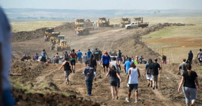 Activists in North Dakota confront pipeline construction activities. A Texas bill would impose steep penalties for such protests. (Photo: Speak Freely/ACLU)