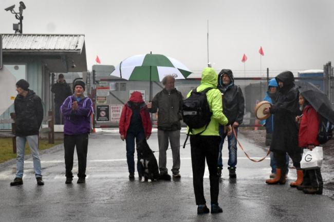 Protesters, including Stacy Gallagher (second from left) stand in the driveway of Trans Mountain's Burnaby Mountain tank farm on Dec. 2, 2019. Photograph By KELVIN GAWLEY
