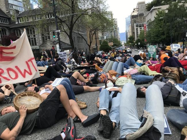 """Activists stage a """"die-in"""" to protest old-growth logging in Vancouver. Photo: Pa-to-ri-ku."""