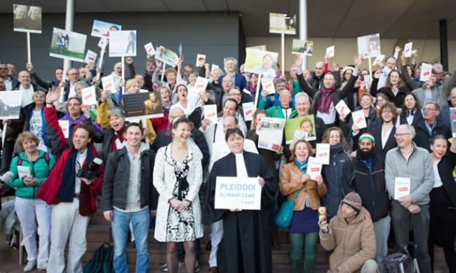 Urgenda supporters celebrate at The Hague after court ruling requiring Dutch government to slash emissions. Photograph: Chantal Bekker/Urgenda