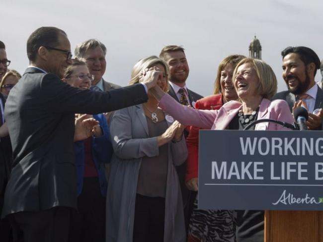 Alberta Premier Rachel Notley high fives Finance Minister Joe Ceci at a press conference to speak about the Kinder Morgan pipeline project, in Edmonton on Tuesday, May 29, 2018.THE CANADIAN PRESS/Jason FransonJASON FRANSON / THE CANADIAN PRESS