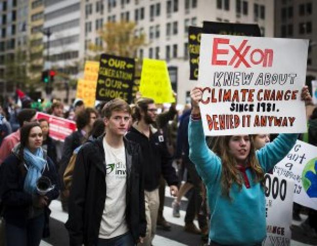Exxon climate protesters during climate rally march in Washington, D.C., November 10, 2015. Photo Credit: Johnny Silvercloud/Flickr CC