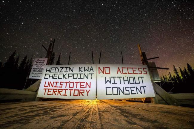 Visitors to Unist'ot'en territory are greeted with a sign ensuring there's no confusion around their recognized governance. Photo by Jeffrey Nicholls