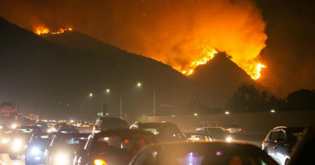 Fire is seen near Getty Center in Los Angeles, the United States, Oct. 28, 2019. Thousands of residents were forced to evacuate their homes after a fast-moving wildfire erupted early Monday morning near the famous Getty Center in Los Angeles in the western U.S. state of California. (Photo: Qian Weizhong/Xinhua via Getty)