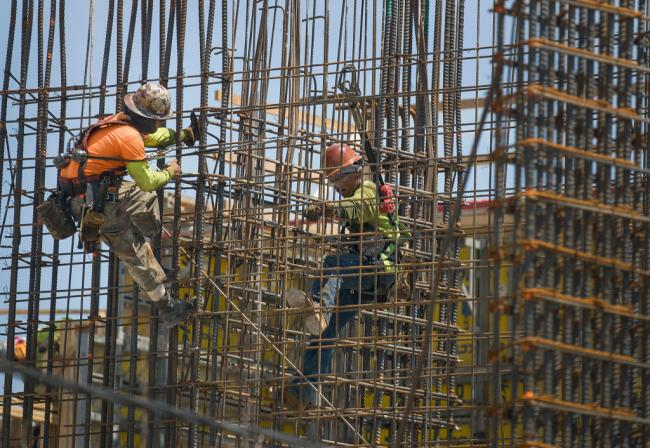 Construction workers are seen as they work with steel rebar during the construction of a building on May 17, 2019 in Miami, Florida. Joe Raedle / Getty