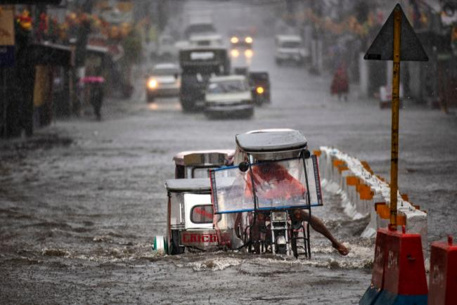 Motorists navigate a flooded highway during the onslaught of Typhoon Kammuri on December 3, 2019 in Lipa town, Batangas province, Philippines. (Ezra Acayan / Getty Images)