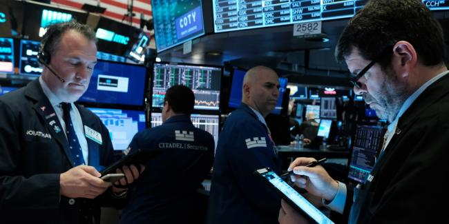 Traders work on the floor of the New York Stock Exchange on March 2, 2020, in New York City. Stocks were up slightly in morning trading following a week that saw a massive sell-off due to fears over a new coronavirus. Photo: Spencer Platt/Getty Images