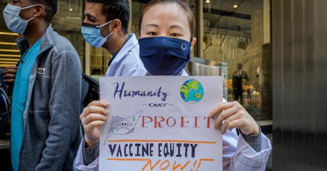 A coalition of healthcare advocacy organizations gathered outside Pfizer Worldwide Headquarters in Manhattan on March 11, 2020. (Photo: Erik McGregor/LightRocket via Getty Images)