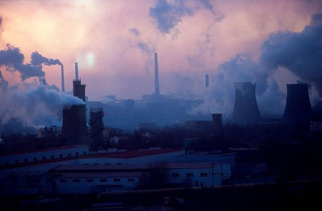 SUN SETS ON THE BAO STEEL MILL IN BAOTOU, INNER MONGOLIA, CHINA. BAOTOU, A ONE-INDUSTRY TOWN, IS ALSO NOTORIOUS AS A BIG POLLUTER, MOSTLY FROM THE LARGE BAO STEEL FACTORY. (PHOTO CREDIT: RYAN PYLE/CORBIS VIA GETTY IMAGES)