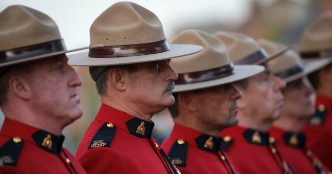 Royal Canadian Mounted Police parade following the Last Post ceremony in front of the Menin Gate Memorial to the Missing on April 6, 2017 in Ypres, Belgium. (Photo: Jack Taylor/Getty Images)