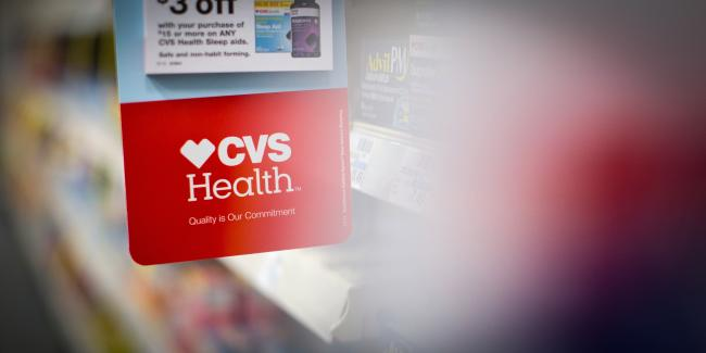 A sign with the CVS Health Corp. logo is seen within a CVS pharmacy store in Los Angeles on Oct. 27, 2017. Photo: Christopher Lee/Bloomberg via Getty Images