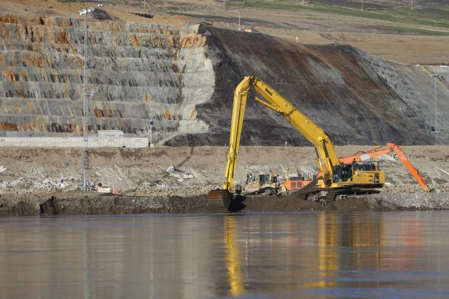 Part of the Site C dam worksite in July 2020. The $10.7 billion dam is the largest publicly funded project in B.C.'s history. It will flood 128 kilometres of the Peace River and its tributaries, in the heart of Treaty 8 territory. Two Treaty 8 First Nations are awaiting court dates for civil claims asserting that the Site C dam, along with two previous dams on the Peace River, violate their constitutionally protected treaty rights. Photo: Don Hoffmann