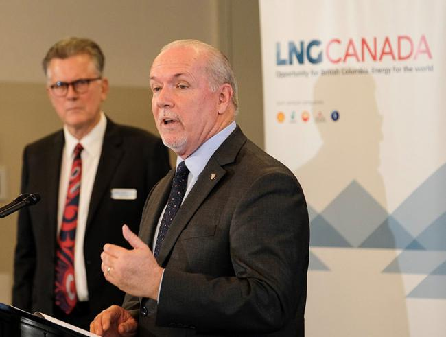 Premier John Horgan in Kitimat announcing LNG Canada's $40 billion investment in 2018. At the time, BC said fracked gas fit its climate action goals, but a new study doubles emissions estimates. Photo: BC government Flickr.