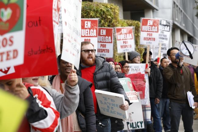 Teachers at The Accelerated Schools, a community of public charter schools in South Los Angeles picket outside the school on second day of the Los Angeles school teachers strike on January 15, 2019 in Los Angeles, California. (Photo by Al Seib / Los Angeles Times via Getty Images)