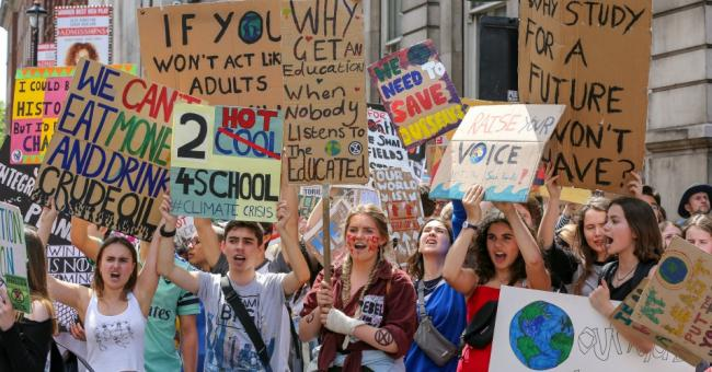 Students seen holding placards while chanting slogans during a youth-led climate protest in London on May 24, 2019. (Photo: Dinendra Haria/SOPA Images/LightRocket via Getty Images)