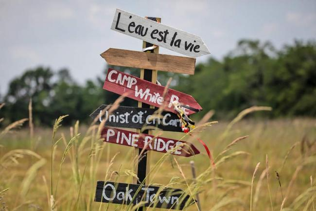 Signs from L'eau Est La Vie protest camp in Louisiana. Credit: ©2018 Julie Dermansky