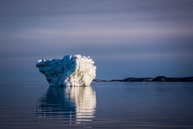An iceberg off Cape Dorset, an Inuit community in Nunavut, Canada. There is growing evidence that Nunavut's glaciers are shrinking, in part due to iceberg calving as a result of climate change.Credit...Sergey Ponomarev for The New York Times