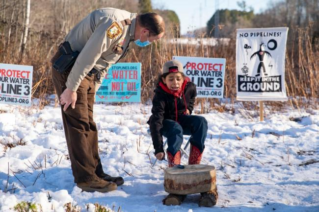 A young Line 3 protester in Palisade, Minn., near a construction site this month.Credit...Alex Kormann/Star Tribune, via Associated Press