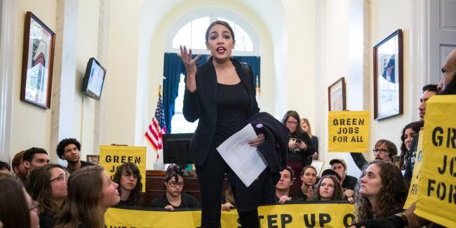 Alexandria Ocasio-Cortez, congresswoman-elect from New York, speaks to activists with the Sunrise Movement protesting in the offices of House Minority Leader Nancy Pelosi, D-Calif., in Washington D.C. on Nov. 13, 2018. Photo: Sarah Silbiger/The New York Times via Redux