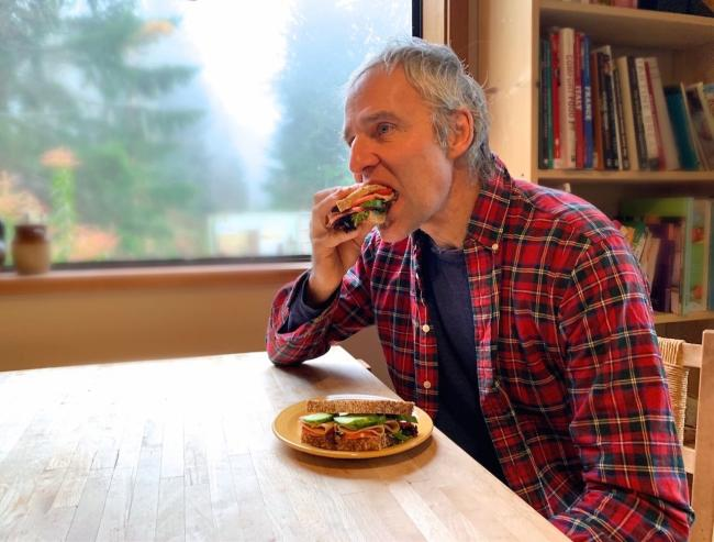 """Johann Wieghardt trying out plant-based deli meats for the first time. """"Better than I thought it would be. Would consider eating it if I was going to become vegetarian,"""" he said. Photo by Rochelle Baker"""