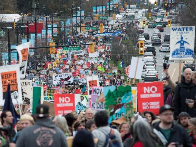 Thousands of people march during a protest against the Kinder Morgan Trans Mountain Pipeline expansion, in Vancouver, B.C., on Saturday November 19, 2016. DARRYL DYCK / THE CANADIAN PRESS