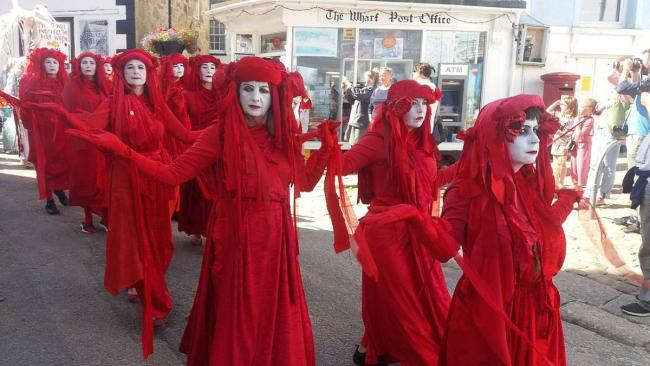 The Red Brigade first showed up last year at Extinction Rebellion protests in the United Kingdom. GAZAMP