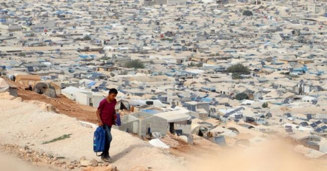 A camp for Syrian refugees near the village of Qah near the Turkish border in the northwestern Idlib province, on October 28, 2020, during the Covid-19 pandemic. Global health campaigners are fighting to ensure that the world's most vulnerable people get adeaquate access to future coronavirus vaccines. (Photo: Ahmad al-Atrash/AFP/Getty Images)