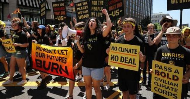 """Hundreds of young climate activists marched to the White House to demand a meeting with U.S. President Joe Biden about infrastructure legislation and to reiterate their message, """"No Climate, No Deal."""" (Photo: Chip Somodevilla/Getty Images)"""