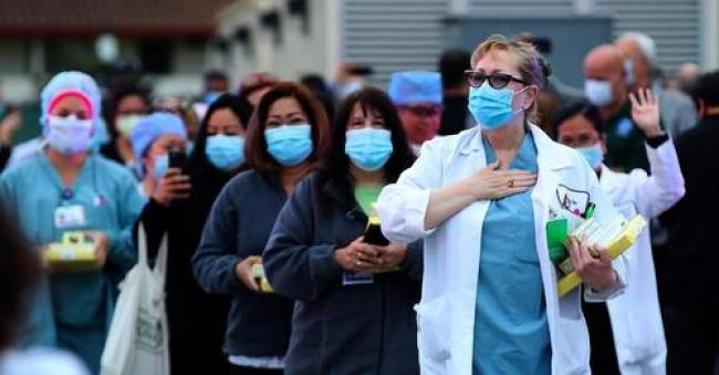 Nurses leave Kaiser Hospital at the end of their shift on May 14, 2020 in South San Francisco, California. Thousands of Kaiser Permanente nurses are among the workers who voted to strike this month. (Photo: Justin Sullivan/Getty Images)