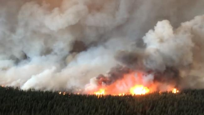 The South Stikine River fire just east of Telegraph Creek, B.C., has grown to around 60 square kilometres in size. The B.C. Wildfire Service said it was burning 'aggressively' on Monday and jumped the Stikine River. (B.C. Wildfire Service)